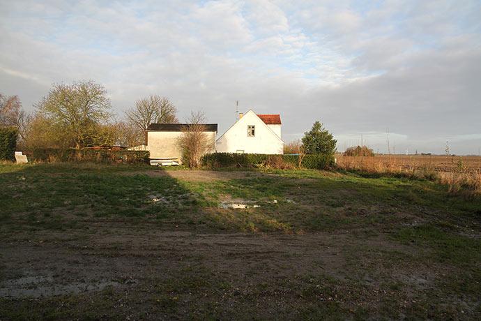 Her foran vores hus stod et meget stort toetagers hus, som brændte først i marts måned.